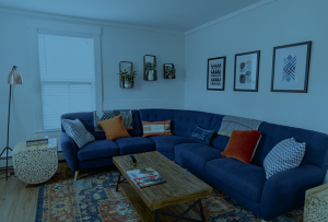 Welcoming living room with a navy blue couch