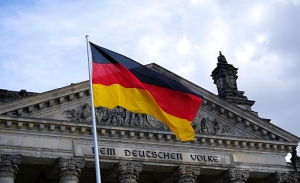 High German section image. Photo of German flag infront of important building.