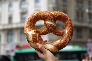 Basic Phrases in German section image. Photo of famous German pretzel in Germany.