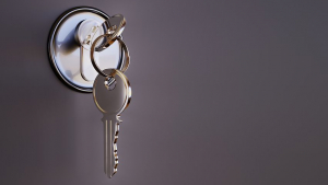 German Housing-Related Phrases section image. Photo of key and keyhole.