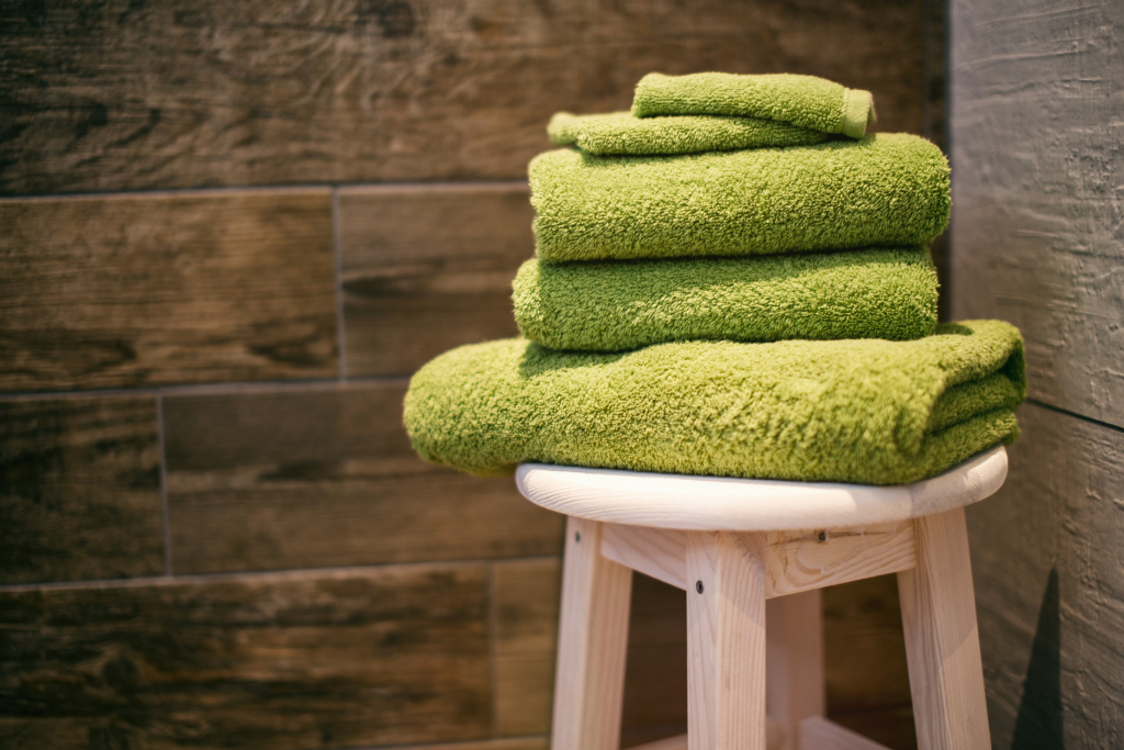 Stock up the Bathroom Section Image. Photo of a stack of clean towels.