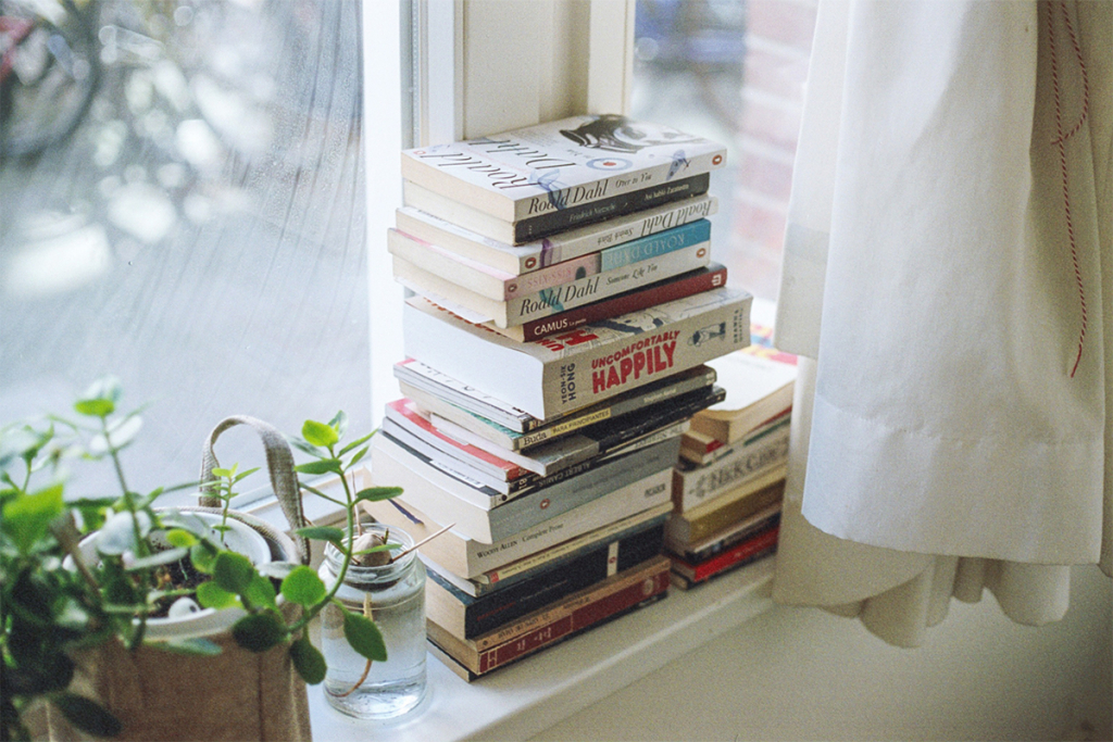 Stack of Books to read by a window.