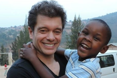 Michael Stromme with Angie in Rwanda