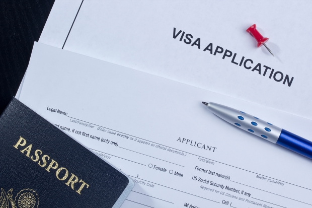 Photo of travel visa application and passport