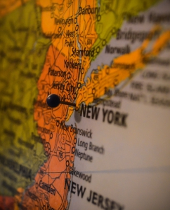 Photo of map of New York with pin in it by Steve Richey on Unsplash