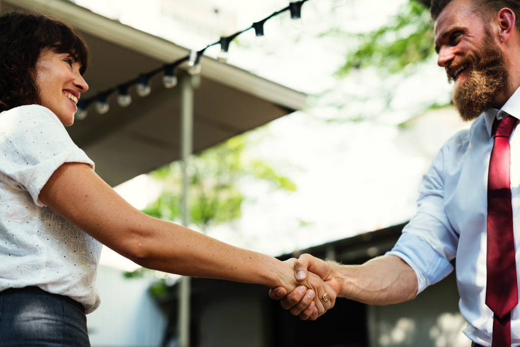 French Greeting Phrases Section Image. People greeting eachother through a handshake.