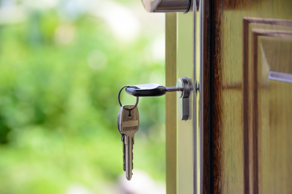 French Housing-Related Phrases. Photo of key in keyhole.