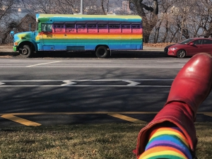 Exploring Manhattan Image. Photo of a rainbow bus and Suzann-Viola's rainbow tights near Columbia University's Morningside Heights campus.