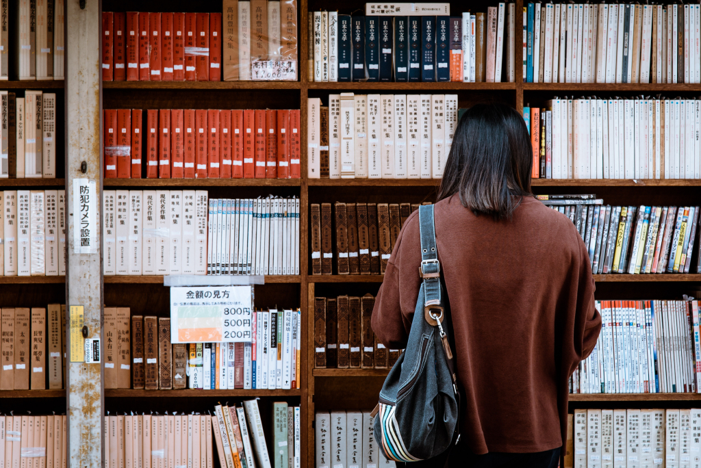 Extra Resources image: woman reading in a library