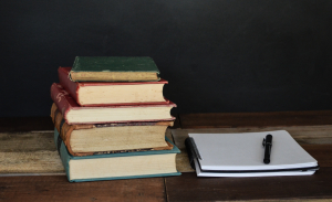 Everything You Need to Know About Becoming a Visiting Scholar Featured Image: Photo of books and Notebook