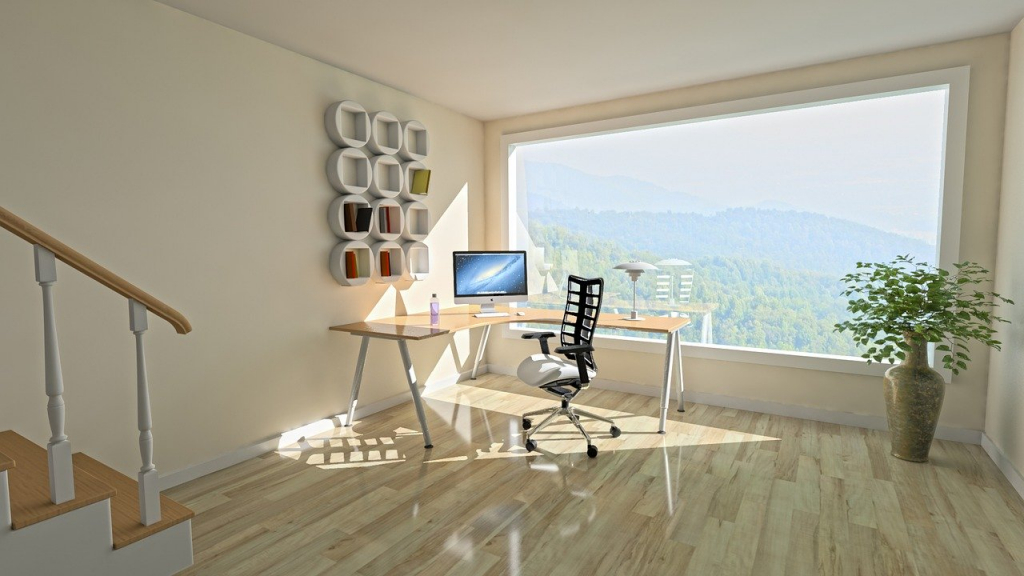 Photo of home office overlooking green hills.