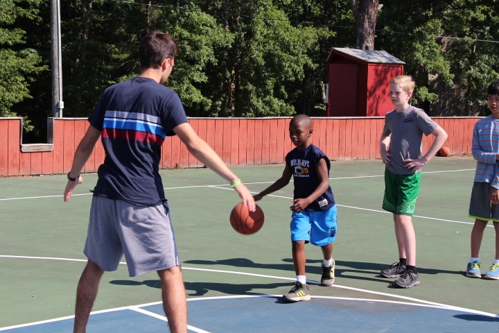 Joe and Laura Iovino Foundation Counselor Playing Basketball with Campers.