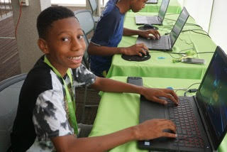 Iovino foundation camper working on a computer.