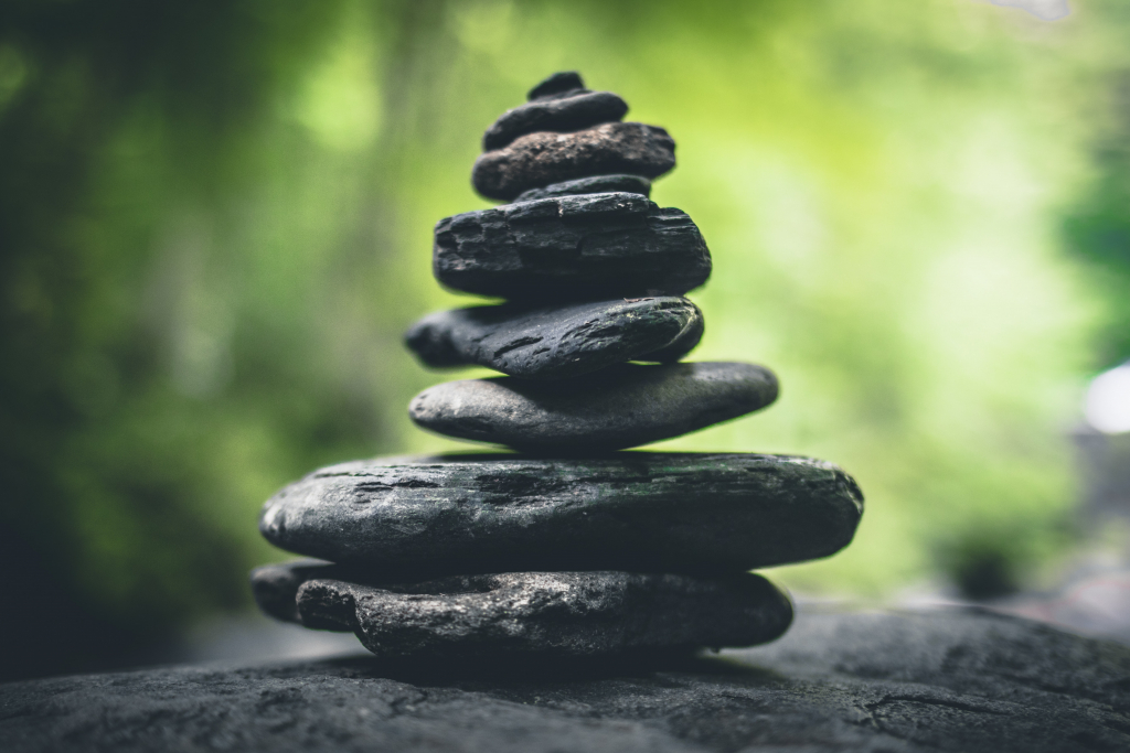 Image of stacked rocks in a forest.