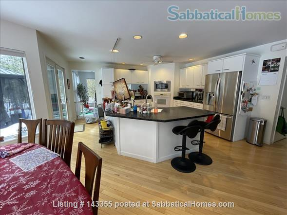SabbaticalHomes.com Listing #143355. Spacious contemporary kitchen in light-filled Ithaca, New York home.