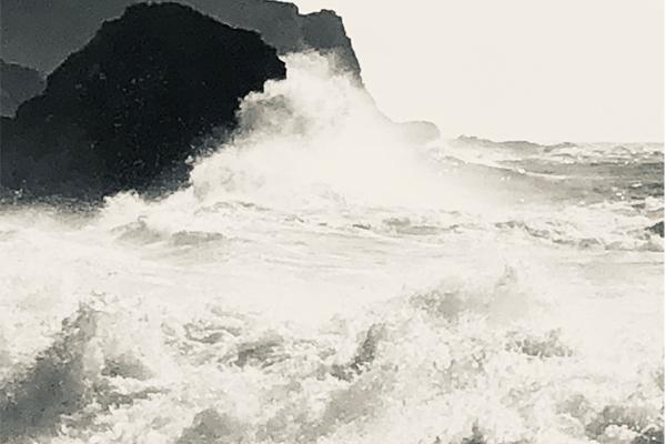 Water breaking over the rocks in Big Sur California.